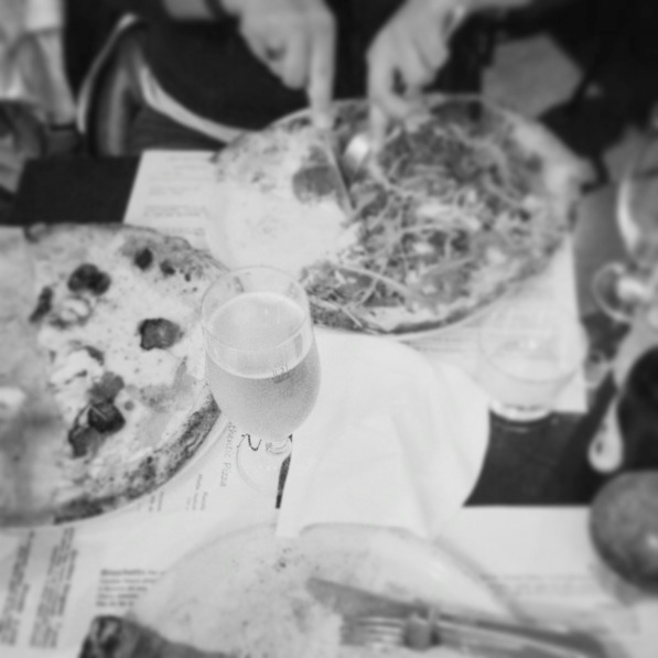 Eating pizza with the siblings in a restaurant that feels like italy