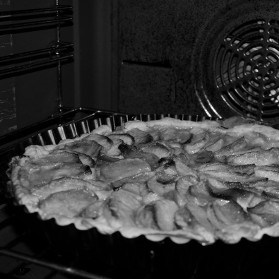 apple pie being cooked in the oven