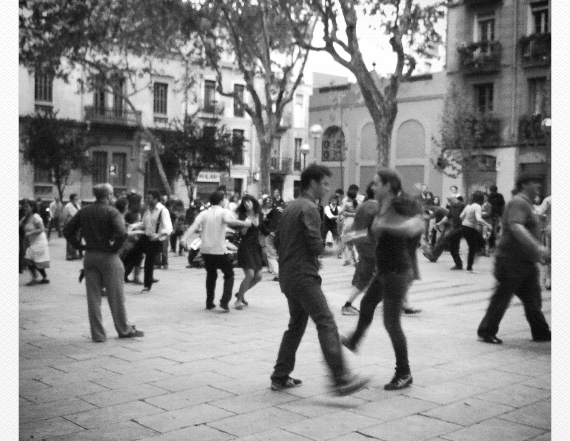 people dancing swing on a town square