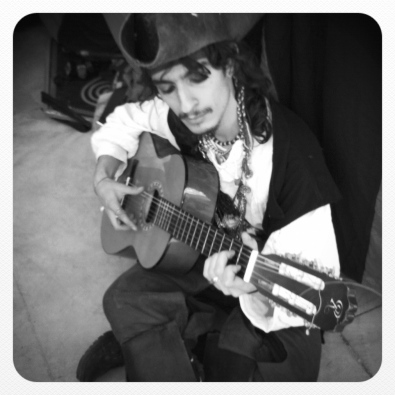 Singing and guitar playing Captain Jack sparrow
